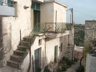 Cretan Homes - exterior view old stone house before renovation