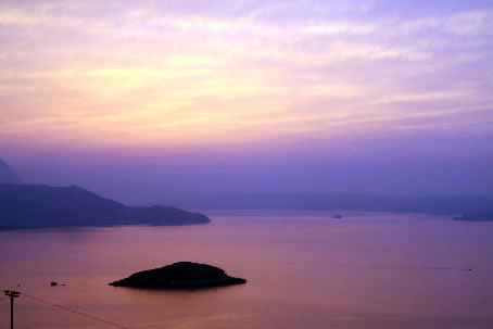 Sunset over Souda Bay from Plaka